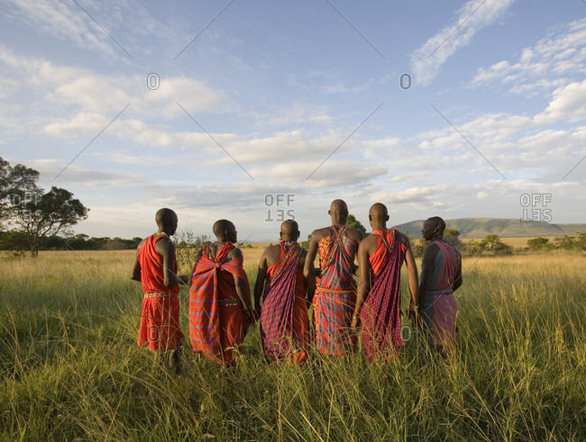 Masai Mara, Kenya - August 7, 2006: Masai tour guides dancing a traditional dance
