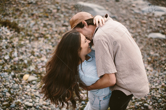 Young couple kissing shot from above
