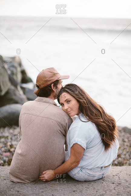 Couple sitting together on the beach