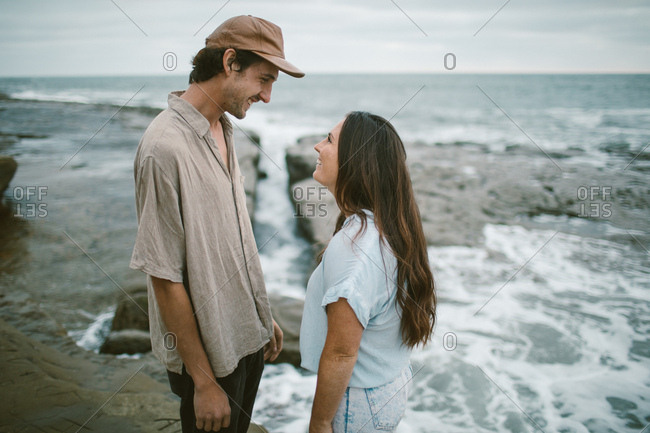 Couple looking at each other standing in tide pools