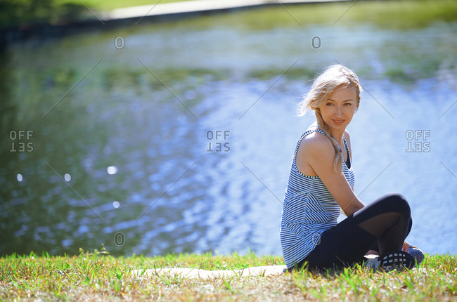 Woman at the lake relaxing after exercise