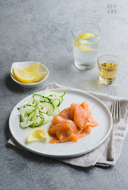 Smoked salmon served with a cucumber salad