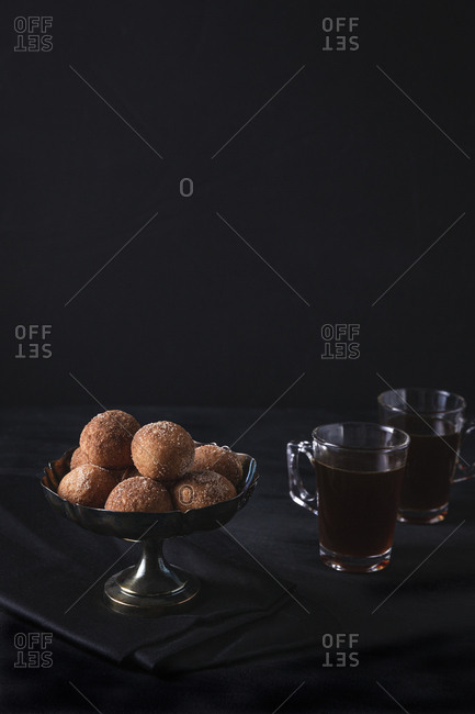 Cinnamon sugar donut holes served with coffee