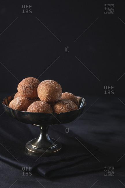 Silver bowl with cinnamon sugar donuts
