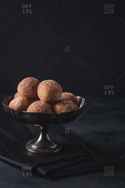 Silver bowl with cinnamon sugar donuts