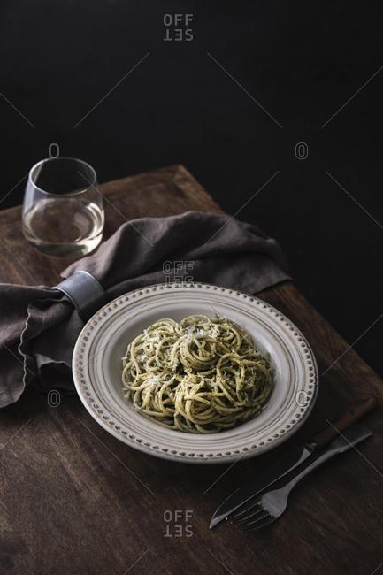 Pesto spaghetti on a table