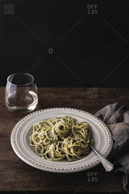 Bowl of pesto spaghetti on table