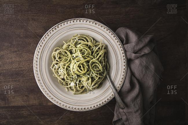 Close up of a plate of pesto spaghetti