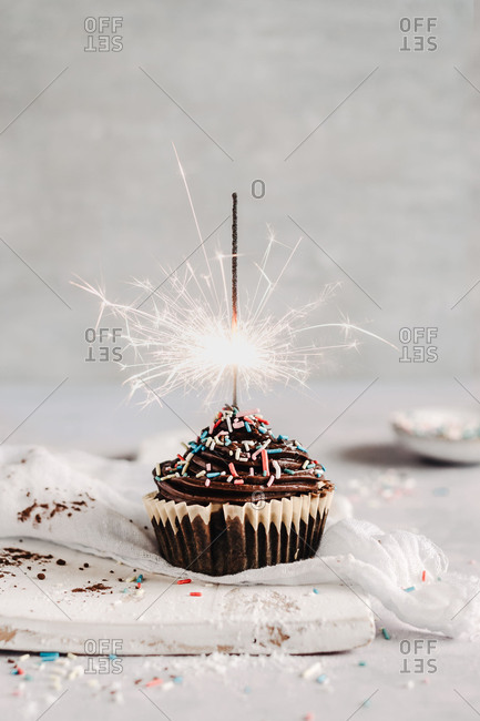 A birthday party cupcake with sparkler