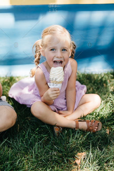 Little girl eating ice cream at the Alameda County Fair, California