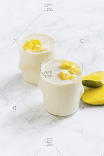 Mango banana smoothie with fresh mango and coconut