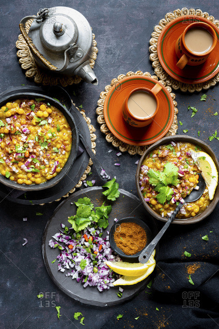 Indian vegan lentil curry served with chopped onion, green chiles, cilantro , fresh ground spices and freshly made chai.