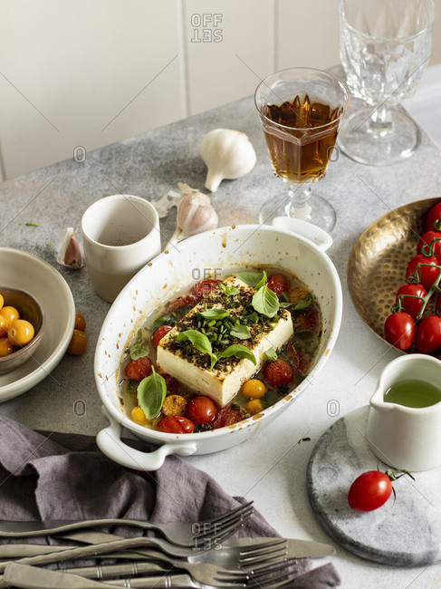 Baked feta cheese with cherry tomatoes and herbs