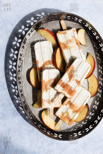 Peach and cashews popsicles on a metal tray
