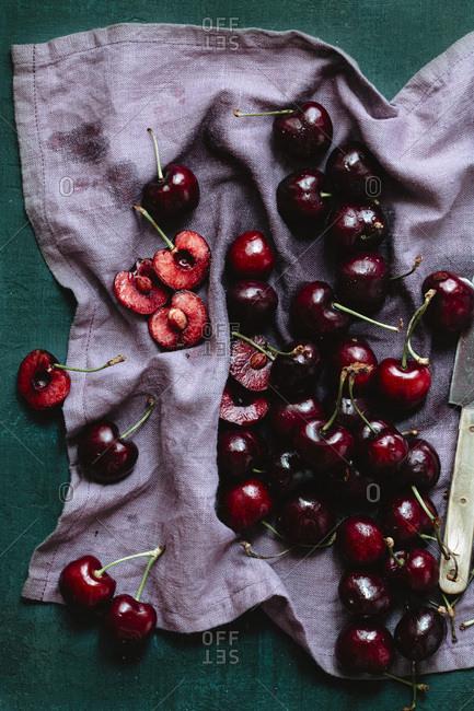 Pitting cherries on a napkin