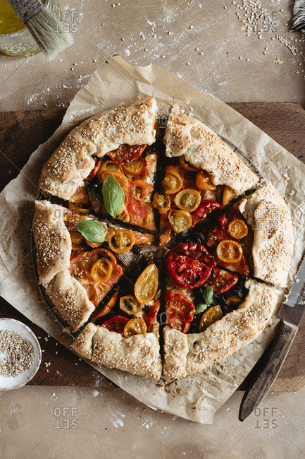 Delicious sliced tomato galette on a cutting board