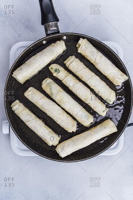Turkish sigara borek frying in a pan