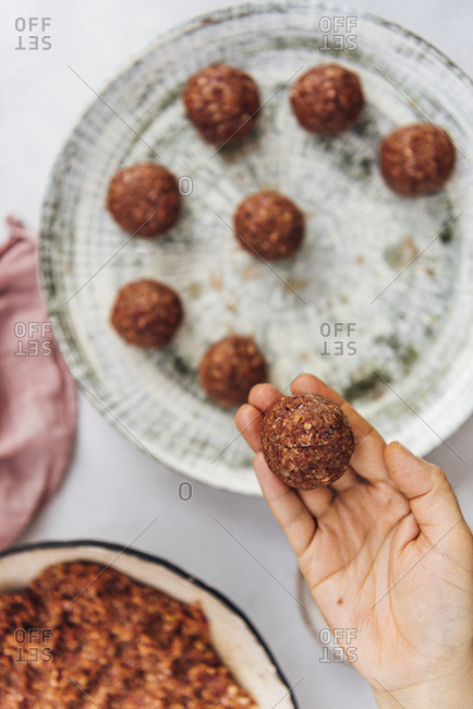 Shaping the raw meatball mixture into balls