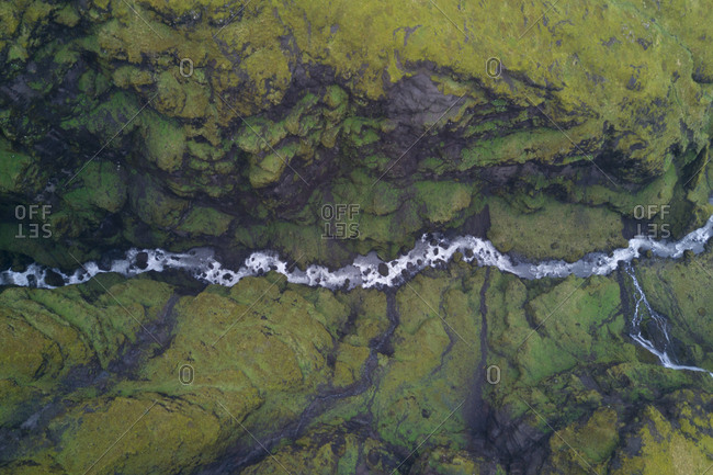 Aerial view about 100 meters above an Icelandic river, shot by drone.