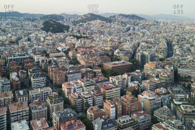 A view over Barcelona, Spain at sunset from a drone a few hundred feet above the city.