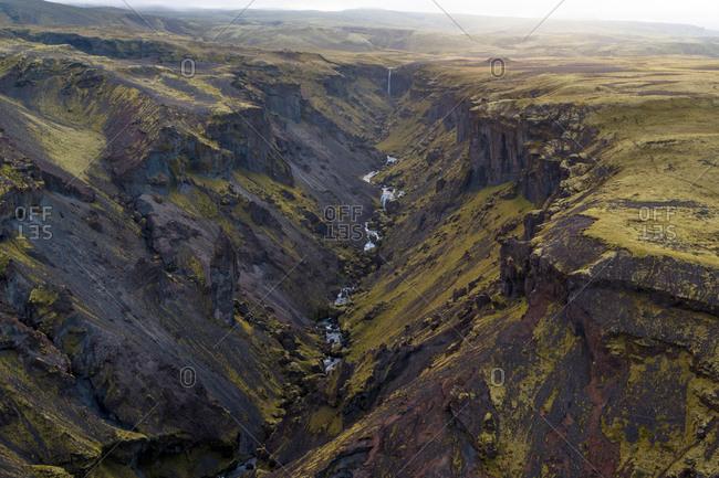 Secret waterfall above the legendary waterfall of Kvernufoss in Skogar.