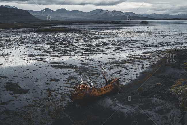 An abandoned shipwreck off the coast of  the Snafellsnes peninsula, in western Iceland.