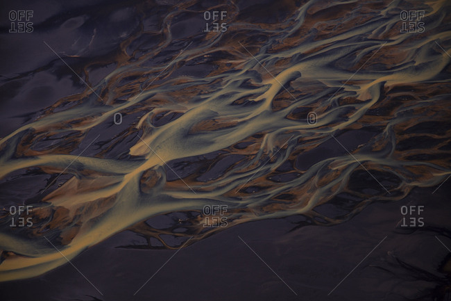 Braided rivers in Iceland, the color is from thousands of years of sediment moving from some of the many volcano's to the seas over the course of history.