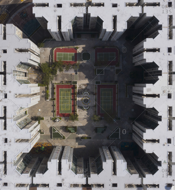 Looking down onto tennis courts from a drones' perspective within the Kowloon district of Hong Kong.