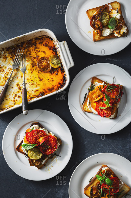 Bruschetta with cheese and baked tomatoes