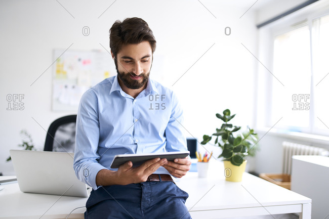 Businessman using a digital tablet in his office