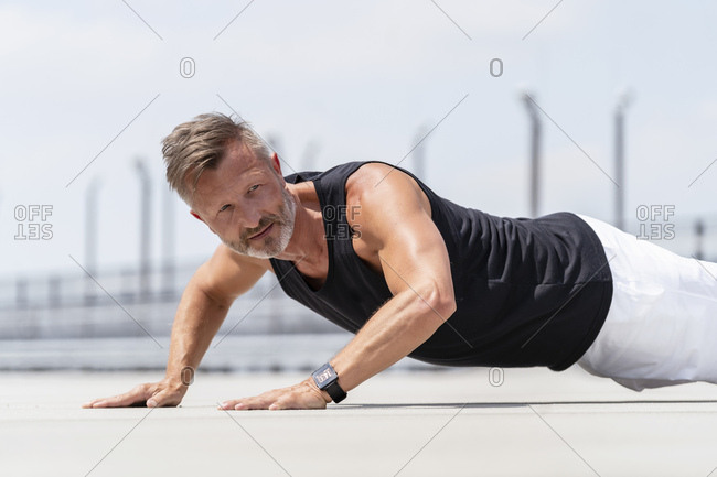 Sporty man making pushups outside