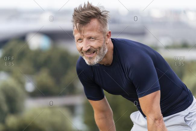 Portrait of a sporty man standing outside