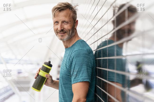 Portrait of sporty man taking a break after workout