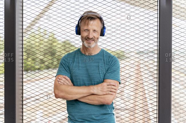 Portrait of a sporty man wearing headphones