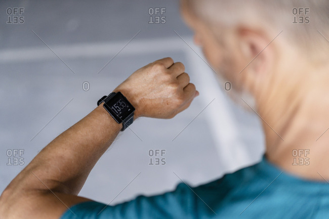Sporty man checking his smart watch