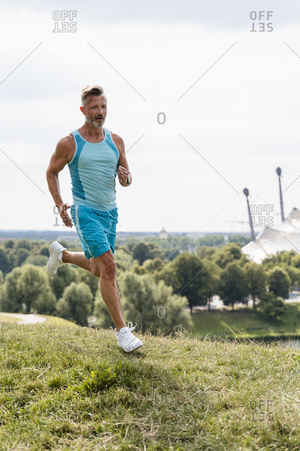 Sporty man jogging in a park