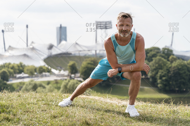 Sporty man stretching in a park