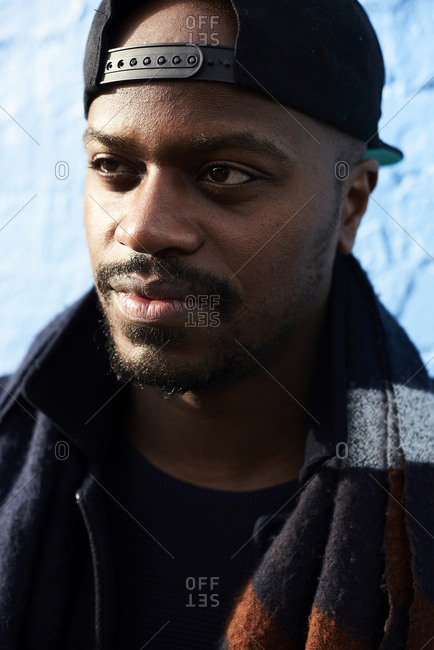 Portrait of man wearing baseball cap and scarf