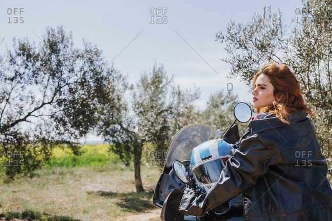 Redheaded woman on motorbike taking a rest- Andalusia- Spain