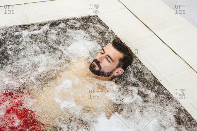 Man enjoying the whirlpool in a spa
