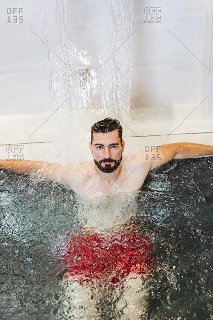 Man enjoying the whirlpool in a spa