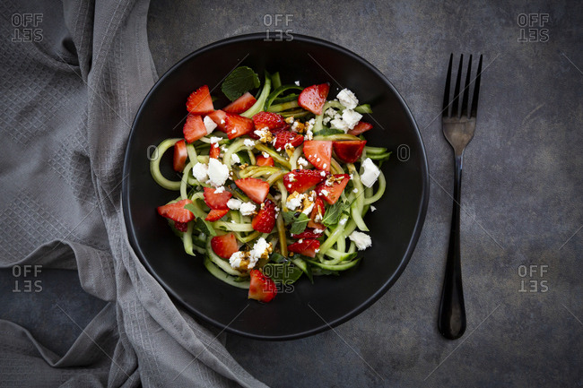 Bowl of strawberry cucumber salad with feta- mint and balsamic vinegar
