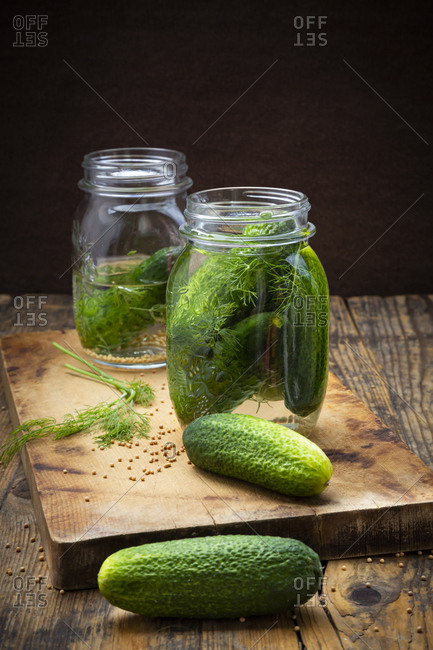Pickled gherkins in jar with mustard seeds and dill