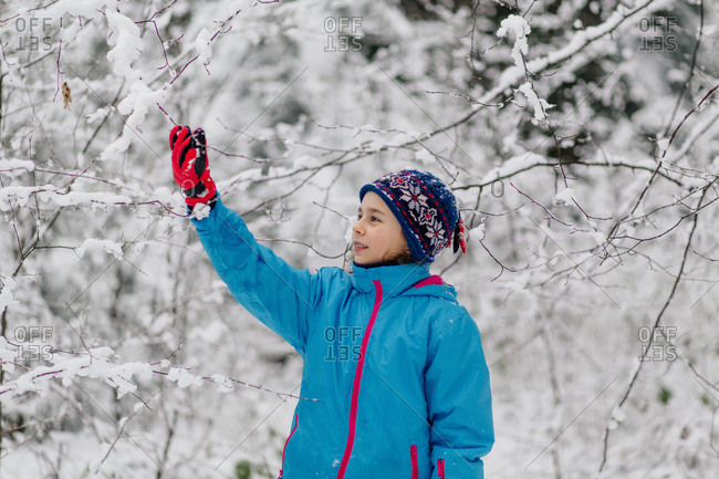 Girl standing in a wintry forest