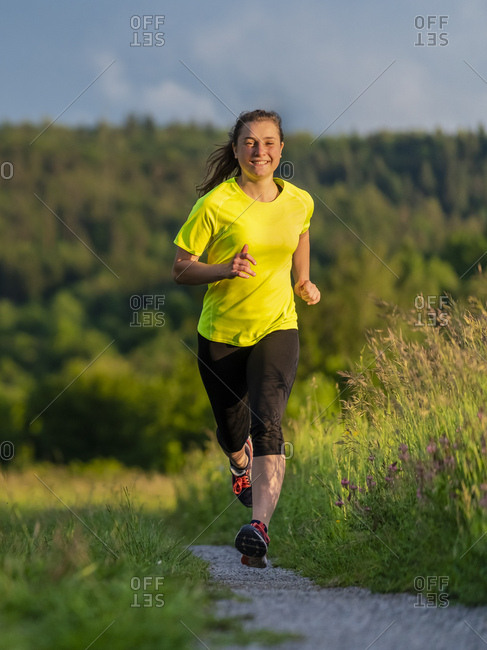 Young woman jogging - Offset Collection