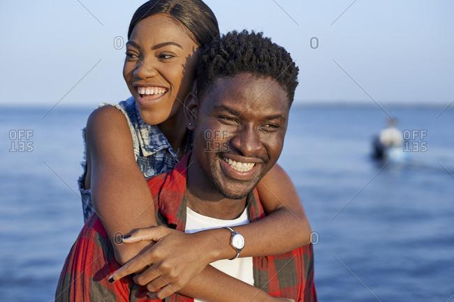 Romantic couple standing at the sea- portrait