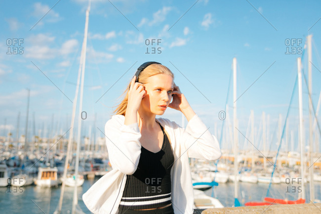 Young woman listening to music, using headphones