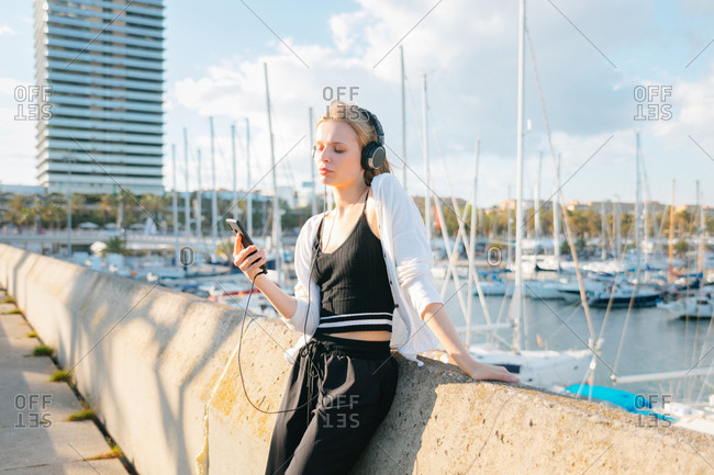 Young woman listening to music on her phone