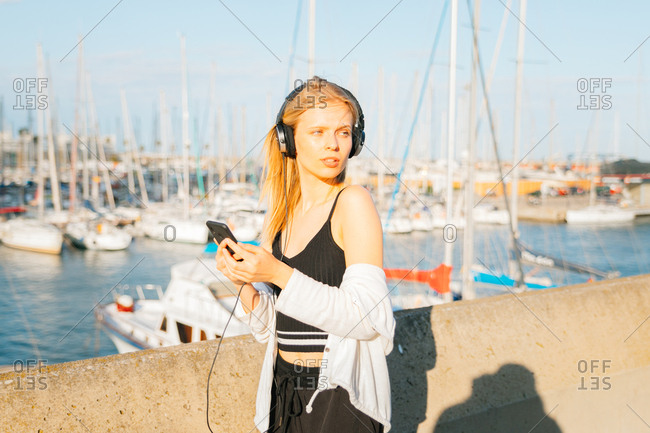 Woman wearing sporty clothes and listening to music