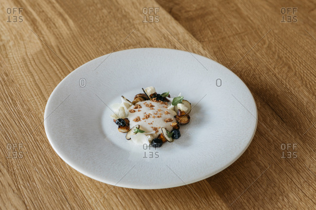 Close up of a gourmet dish on wooden table